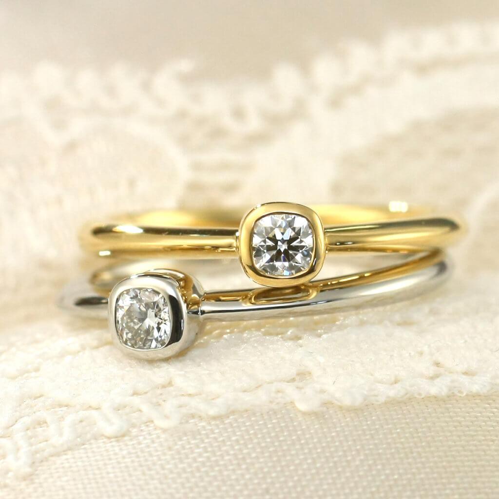 希少なクッションブリリアントカットダイヤモンドを採用したプチエンゲージリング。